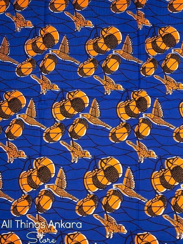 Blue Orange Bird Branches Wax Prints